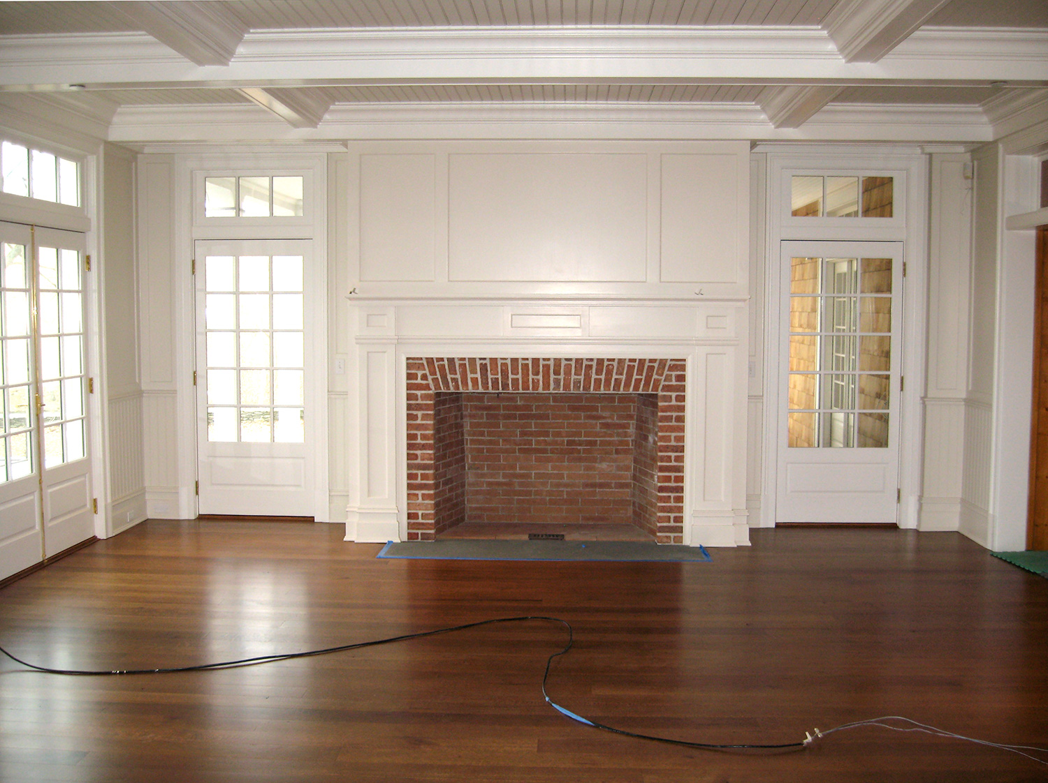 Panel and coffered ceiling set off this fireplace. Hillsdale, NY.